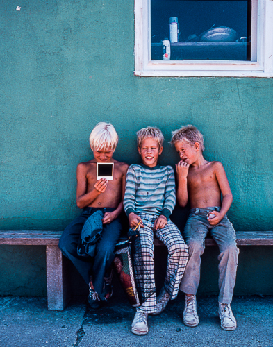 Three Boys and a Polaroid © Jann Alexander