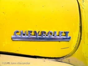 chrome-chevrolet-logo-on-old-yellow-truck