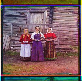 Three young women at their izba, near Kirillov by Sergei Mikhailovich Prokudin-Gorskii, 1909 (Library of Congress)